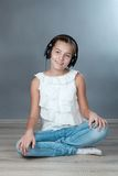 Portrait of beautiful girl on gray background Royalty Free Stock Photo