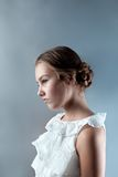 Portrait of beautiful girl on gray background Stock Images