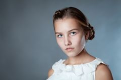 Portrait of beautiful girl on gray background Royalty Free Stock Image
