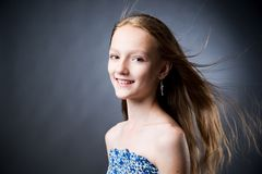 Portrait of a beautiful girl on a gray background Royalty Free Stock Photo