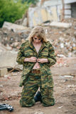 Portrait of a beautiful girl in green camouflage and topless wit. H a gun in hands Royalty Free Stock Photography