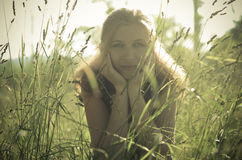 Portrait of a beautiful girl in the green grass, Royalty Free Stock Images