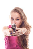 Portrait of a beautiful girl with a gun. Shooting studio Royalty Free Stock Photos
