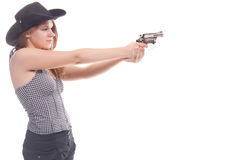 Portrait of a beautiful girl with a gun. Shooting studio Stock Photography