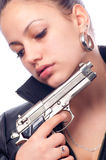 Portrait of the beautiful girl with gun Royalty Free Stock Photos