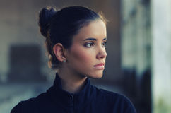 Portrait of beautiful girl in gym suit before fitness workout Royalty Free Stock Image