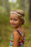 Portrait of a beautiful girl with hairstyle in the Greek style summer day in the forest Stock Photos