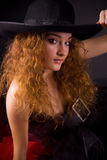 Portrait of a beautiful girl in hat. Studio shot stock image