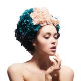 Portrait of a beautiful girl in the hat of flowers. Isolated on a white background Royalty Free Stock Photos