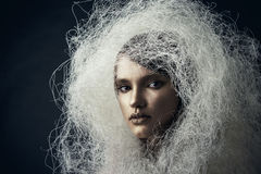 Portrait of a beautiful girl in a headdress of white Plaited Royalty Free Stock Images