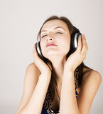 Portrait of beautiful girl in headphones, listening music, singing a song  on white, lifestyle people concept Stock Photos