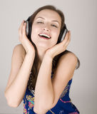 Portrait of beautiful girl in headphones, singing a song Royalty Free Stock Photography