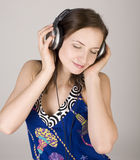 Portrait of beautiful girl in headphones, singing a song Stock Image