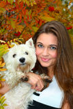 Portrait of beautiful girl with her dog royalty free stock images