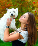 Portrait of beautiful girl with her dog Stock Photography