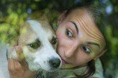 Portrait of beautiful girl and her dog Stock Image