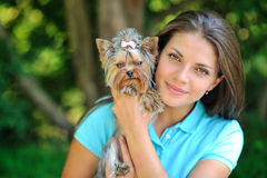 Portrait of a beautiful girl with her puppy in a park - closeup Stock Photo