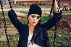 Portrait of a beautiful girl hipster on a swing Stock Photography