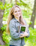 Portrait of beautiful girl holding books in their hands Royalty Free Stock Photos