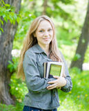 Portrait of beautiful girl holding books in their hands Stock Photography