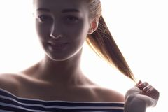 Portrait of beautiful girl, woman face on white isolated background, concept of beauty and fashion stock image