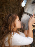 Portrait of a beautiful girl with a horse. Beautiful girl kissing a horse Stock Photos
