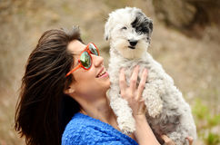 Portrait of beautiful girl hugging her  dog Stock Photography