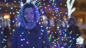 Portrait of beautiful girl with illumination decoration stock video footage