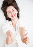 Portrait of a beautiful girl laughing and showing thumb up Royalty Free Stock Photography