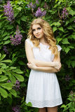 Portrait of beautiful girl with lilac flowers. Beautiful blonde girl with a lilac flowers Stock Photos