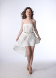 Portrait of a beautiful girl in a little white dress Stock Image