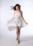 Portrait of a beautiful girl in a little white dress Royalty Free Stock Photo