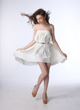 Portrait of a beautiful girl in a little white dress Stock Images