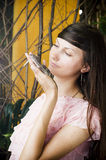 Portrait of beautiful girl with lizard in a greenhouse Royalty Free Stock Photography