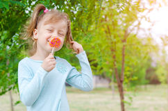 Portrait of a beautiful girl with a lollipop, free space. Happy. Child with a lollipop Stock Image