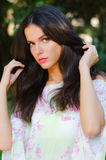 Portrait of beautiful girl with long black hair outdoor in spring Royalty Free Stock Photography