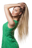 Portrait of girl with long blond hair. Portrait of a beautiful girl with long blond hair in green dress, isolated on white Royalty Free Stock Photos