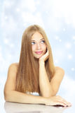 Portrait of a beautiful girl with long hair. On a blue background Royalty Free Stock Photos
