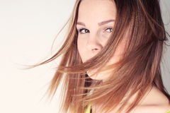 Portrait of beautiful girl with long hair blowing in breeze Royalty Free Stock Photo
