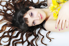 Portrait beautiful girl with long hair with narcissus Stock Photos