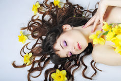 Portrait beautiful girl with long hair with narcissus Stock Image