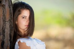 Portrait of a beautiful girl looking with hair in face Royalty Free Stock Image
