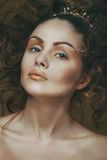 Portrait of a beautiful girl with a luxurious makeup. Royalty Free Stock Images