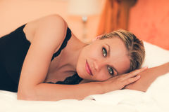 Portrait of a Beautiful Girl Lying on the Bed Stock Photo