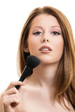 Portrait of a beautiful girl with a make up brush royalty free stock photo