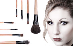 Portrait of beautiful girl with makeup brushes Royalty Free Stock Photos