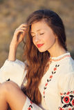 Portrait of beautiful girl in meadow in national suite stock photos