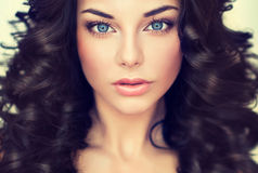 Portrait beautiful girl model with long black curled hair Stock Photos
