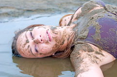 Portrait of a beautiful girl in the mud. Stock Photo