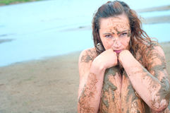 Portrait of a beautiful girl in the mud. Stock Photos